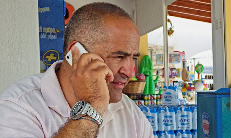Takis Koumbaros on telephone